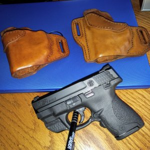 Jeff Quinn's S&W Shield w/CT Green Laser and a couple or WW Wright  Belt Slides ';-)